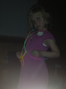 Cierra showing off her handcrafted glow stick / laser light dance party costume