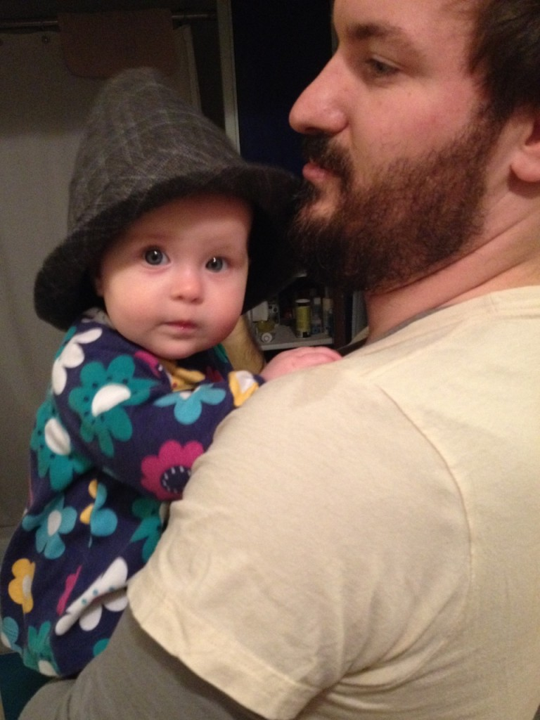 Looking dapper in Daddy's hat
