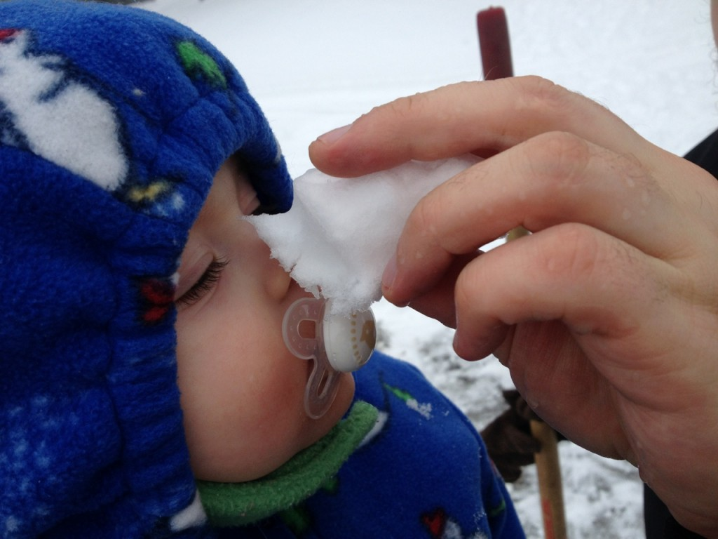 Zakk touches Colette's nose with snow
