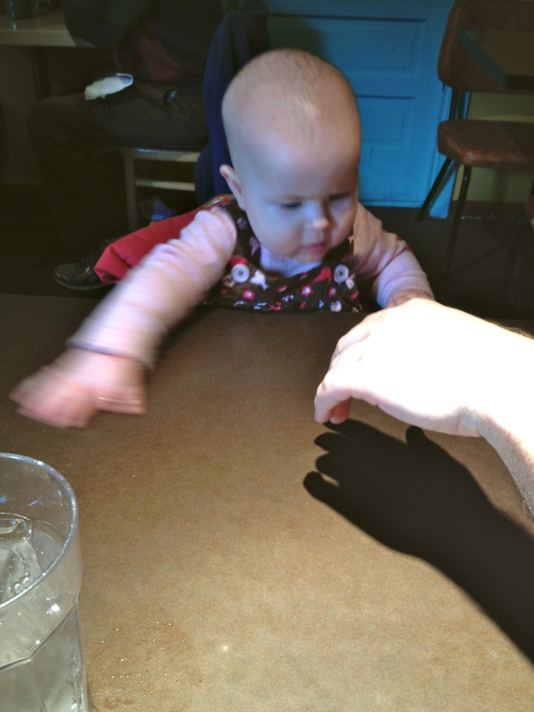 Trying to touch Daddy's shadow hand